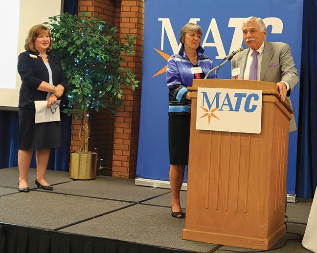 Dr. Vicki J. Martin looks on as Julie Ebert and Frank Daily were honored for their donations to the Promise program. They also served as part of the campaign cabinet that helped raise the funds from other donors.