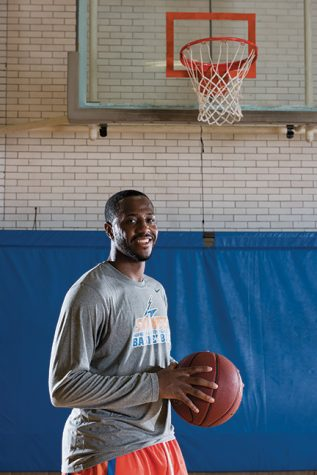 Basketball star Thomas Hood dribbles on