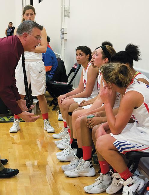 Head Coach Jeff Lorenz motivates the women during a timeout.