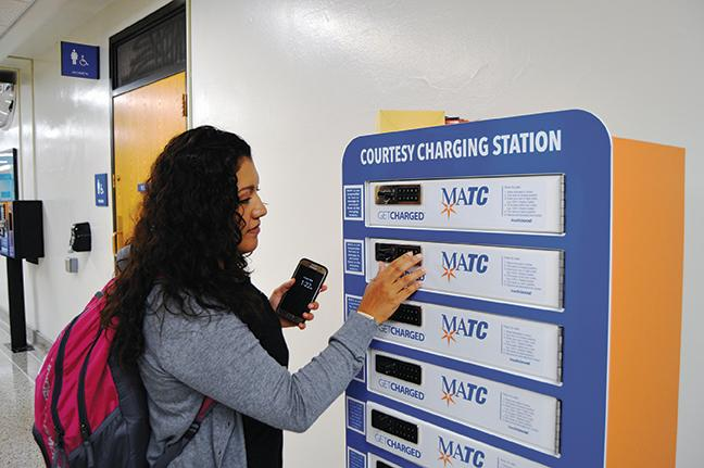 At all MATC campuses, charging stations are placed around so students can use them to recharge items like cellphones or laptops absolutely free. Carina Chavec, a Dental Hygiene program student, is using one of the many charging stations at the Downtown Milwaukee campus to recharge her cellphone for future use.