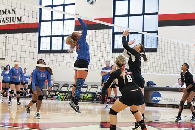 Kayla Backhop #10 went up high to dropshot the ball against a defender on Sept. 10.  The team won one set but lost the game.
