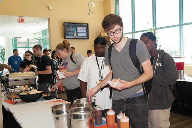 Students, staff and faculty were treated to free chicken wings or chicpea wrap, coleslaw, popcorn, desserts and snow cones while being welcomed to the 2016-17 school year.