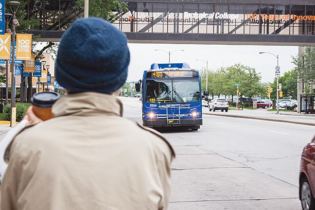 The Route 80 bus approaches the bus stop in front of MATC on the corner of 6th and State streets to pick up passengers.
