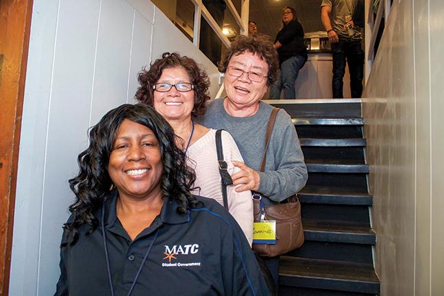 From top, Connie Chaj, Margaret Sippy and Vernita Billups explore the Milwaukee Voyageur.
