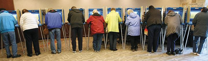 Voters voting at the Menomonee Falls Public Library in Menomonee Falls, Wis., on Tuesday, April 5, 2016. (Michael Sears/Milwaukee Journal Sentinel/TNS)