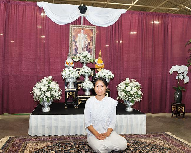 """Apinya Jordan, represents Thailand at the Thai cultural booth. Jordan wrote about her experience at the fair in her book """"I was there at the folk fair."""""""