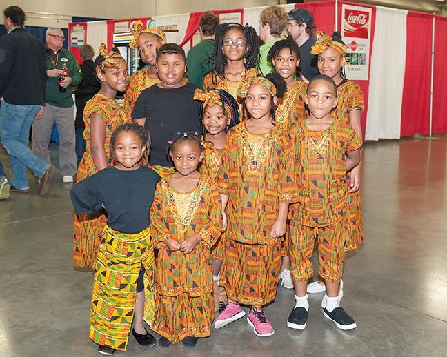 The Nefertari African Dance Company pose for a photo at the Holiday Folk Fair International.