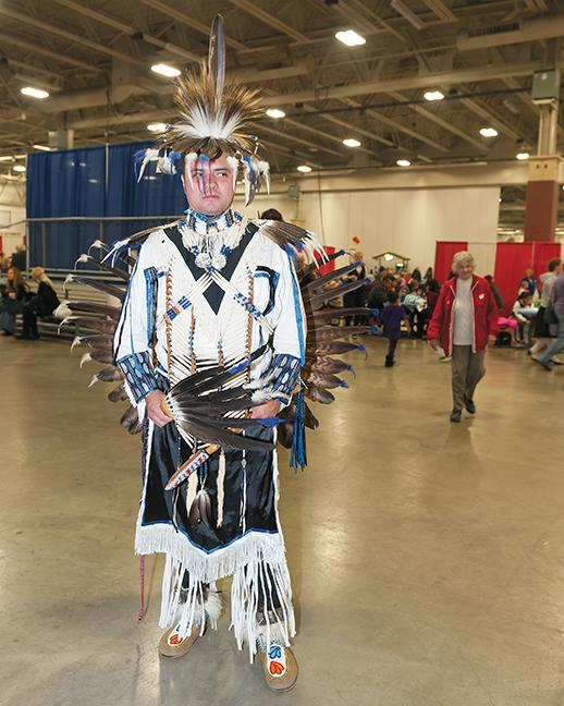 Andrew Ynnocencio, MATC graduate, Graphic Arts program, poses for a photo before he performs a traditional dance.