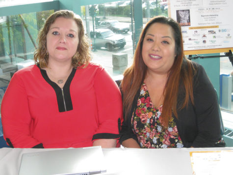 Stacey Heeler (left) and Elizabeth Hang from Hope, Peace, Recovery handed out resource materials for students.