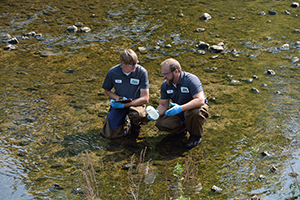 James and Andy collect samples at the Cedar Creek Water Quality Compliance.