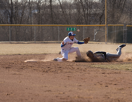 Stormer second baseman Andrew Wilson attempts to tag out the opposing runner.