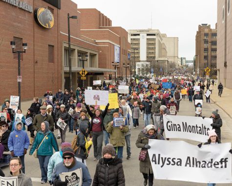 Participants walk down State Street in Milwaukee.