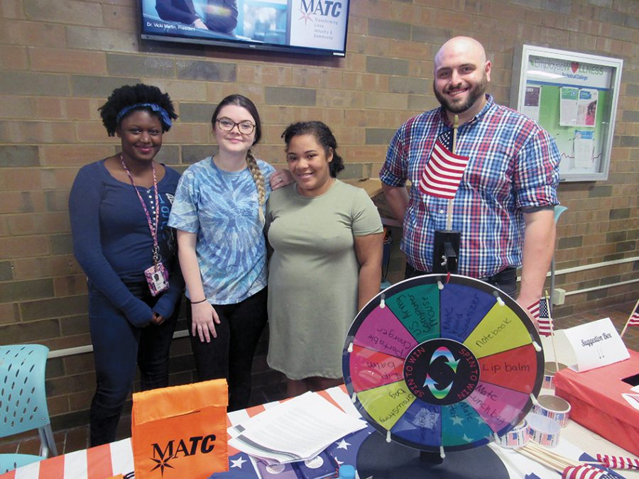 Mequon+Student+Government+members+celebrate+Constitution+Day+on+Sept.+18+with+flags+and+stickers+to+students.+The+students+also+had+an+opportunity+to+win+prizes+by+spinning+the+wheel.