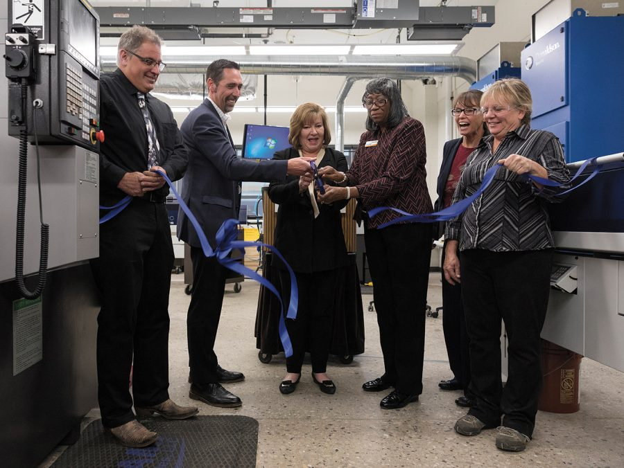 Corey B. Johnson, (second from left) president of Morris Midwest, Dr. Vicki Martin (third from the left) MATC president, and Dorothy Walker, interim dean of MATC's School of Technical and Applied Sciences, cut the ribbon on the college's new CNC Swiss lab on Oct. 17 at the Downtown Milwaukee Campus.